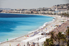 The French Riviera Nice France beach. The French Riviera Cote d'azur Nice France beach on famous Promenade des Anglais hotel lined boulevard Stock Image