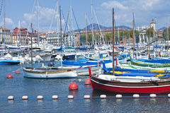 French Riviera Nice Port harbour with colourful boats and super yachts Stock Photos