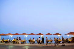 French riviera promenade. At dusk, with people motion blurred royalty free stock image