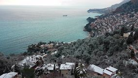 French Riviera Under Snow Panoramic View. Beautiful Panoramic Aerial View of the Sea And The Mountain on The French Riviera Under The Snow. Roquebrune-Cap-Martin stock video footage