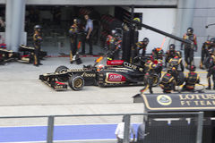 Romain Grosjean exits his pit stop Stock Images