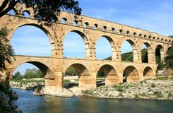 French roman aqueduct named Pont du Gard. The Pont du Gard is an aqueduct in the South of France constructed by the Roman Empire, and located in Vers-Pont-du Stock Photography