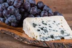 French roquefort cheese with black grapes Royalty Free Stock Photo