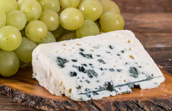 French roquefort cheese with white grapes Royalty Free Stock Image