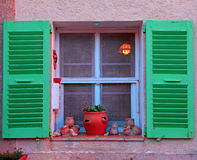 French rustic window with green wood shutters royalty free stock image