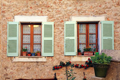 French rustic windows with old green shutters, Provence Royalty Free Stock Images