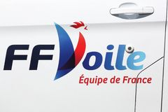 French sailing federation logo on a car. Aarhus, Denmark - August 9, 2018: French sailing federation logo on a car. The French sailing federation is recognised stock photo