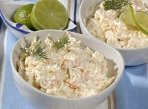 French Salad. Cold salads in white bowls, crabmeat or shrimp salad, garnished with fresh herbs and lime on pale blue cloth royalty free stock image