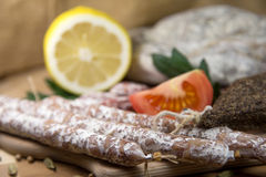 French salami close-up. On wooden table royalty free stock photos