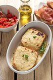 French sandwiches Croque-Monsieur with bechamel sauce. Tomato salad and prosciutto ham stock photography