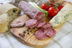 French saucisson with cheese on cutting board stock photo