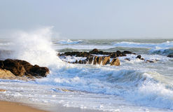 French sea shore with waves and rocks Stock Images