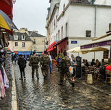 French security forces patrol rainy streets on touristy Montmartre, Paris, France Royalty Free Stock Image