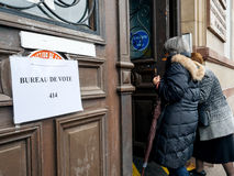 French senior women going to vote polling station bureau de vote. STRASBOURG, FRANCE - MAY 7, 2017: French city with senior women going to polling place during royalty free stock photo