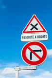 French sign prohibiting a right turn and the priority right. In the street, french sign prohibiting a right turn and the priority right Royalty Free Stock Photo