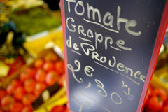 French sign in vegetable market. Sign for tomatoes in french market Stock Image