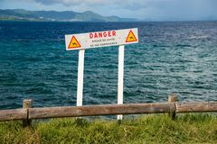 French sign warning people to keep away from a dangerous cliff Stock Photos