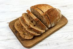 French sliced bread on wooden cutting board royalty free stock photography