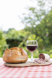 French snack with bread red wine and delicatessen Royalty Free Stock Image