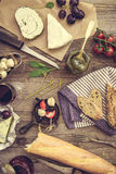 French snacks on a wooden background Royalty Free Stock Photo