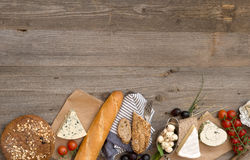 French snacks on a wooden table Stock Photos