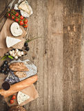 French snacks on a wooden table Stock Images