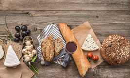 French snacks on a wooden table Royalty Free Stock Photography