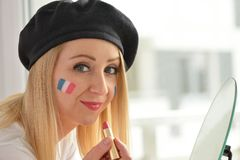 French soccer fan cheers football team. Royalty Free Stock Images