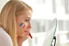 French soccer fan cheers football team. Stock Photography