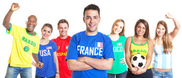 French soccer fan with crossed arms and other fans Royalty Free Stock Image