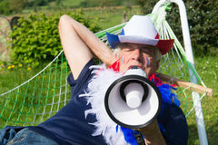 French Soccer fan in hammock Stock Photography