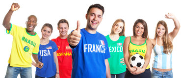 French soccer fan showing thumb up with other fans Royalty Free Stock Images