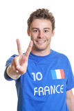 French soccer fan showing victory sign Stock Image