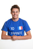French soccer fan on a signboard. Laughing french football fan on a signboard for advertising on a white background Royalty Free Stock Photo