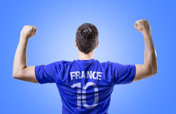 French soccer player celebrating on blue background Stock Photo