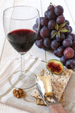 French soft cheese Brie, fruit and wineglass Royalty Free Stock Image