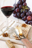 French soft cheese Brie, red grapes and glass of red wine Royalty Free Stock Image