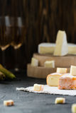 French soft cheese from Brittany region and brie sliced, with pear, glasses of white wine Royalty Free Stock Image