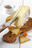 French soft spicy cheese on chopping board olive wood Stock Photography