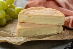 French soft strong smelling cheese Munster from Alsace. Close up Royalty Free Stock Image