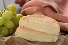 French soft strong smelling cheese Munster from Alsace. Close up Royalty Free Stock Photography