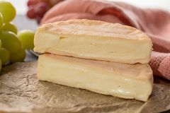 French soft strong smelling cheese Munster from Alsace. Close up Stock Photography