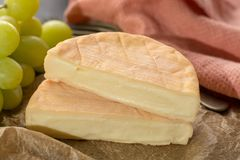 French soft strong smelling cheese Munster from Alsace. Close up Royalty Free Stock Photos