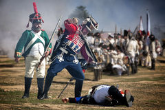 French Soldier attacking enemy soldier during Representation of the Battle of Bailen Royalty Free Stock Photography