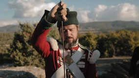 French soldier with a beard cleans muzzle of a gun stock footage