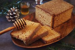 French spice festive Christmas bread and honey. Toned image royalty free stock image