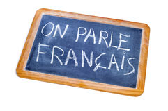 French is spoken. Sentence french is spoken written in french on a chalkboard Stock Photography