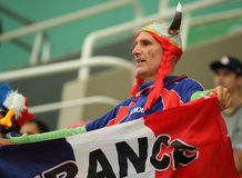 French sport fan supports Team France during Rio 2016 men`s water polo group match between the United States and France. RIO DE JANEIRO, BRAZIL - AUGUST 10, 2016 Royalty Free Stock Photo