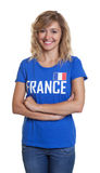 French sports with blond hair and crossed arms Stock Photo