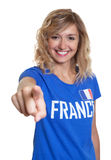 French sports with blond hair pointing at camera Stock Image